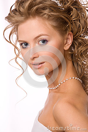 Studio Shot of the bride with her hands near face