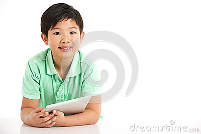 Studio Shot Of Chinese Boy With Digital Tablet