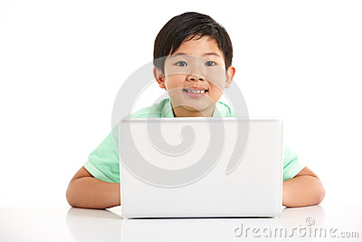 Studio Shot Of Chinese Boy With Laptop