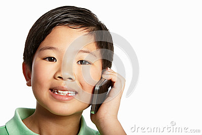 Studio Shot Of Chinese Boy With Mobile Phone