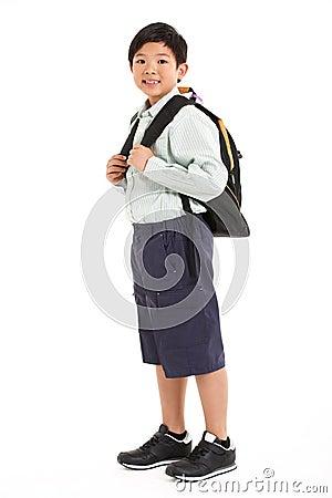 Studio Shot Of Chinese Boy In School Uniform
