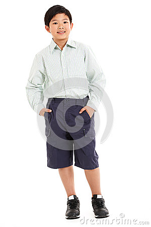 Studio Shot Of Chinese Boy In School Uniform