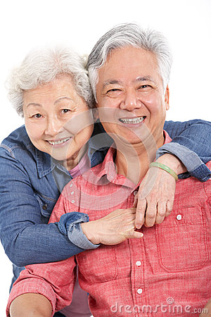 Studio Shot Of Chinese Senior Couple