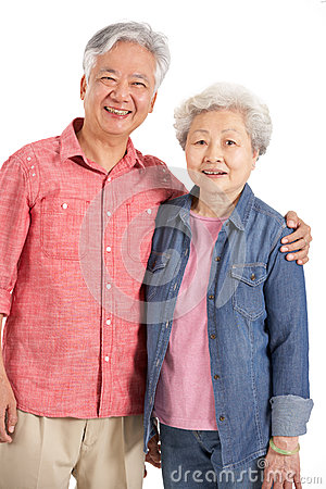 Studio Shot Of Chinese Senior Couple