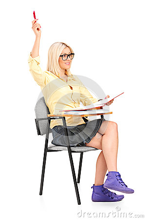 A studio shot of a female student raising her hand