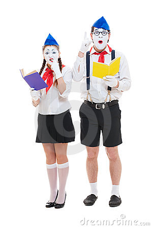 Studio shot of funny mimes with books