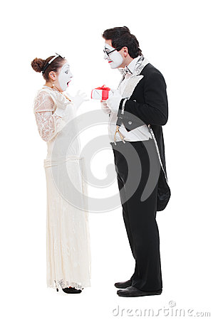 Studio shot of funny mimes with present