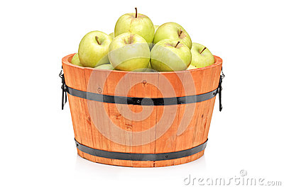 Studio shot of green apples in a wooden barrel