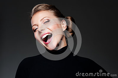 Studio shot of happy young woman