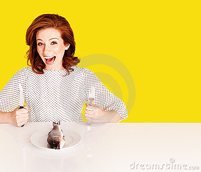 Studio shot of hungry woman on yellow background