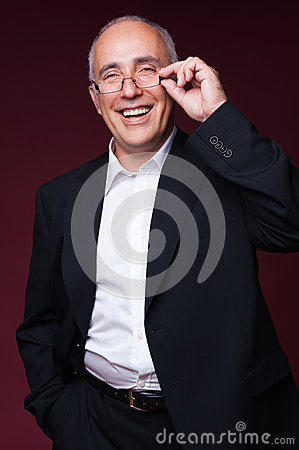 Studio shot of laughing businessman