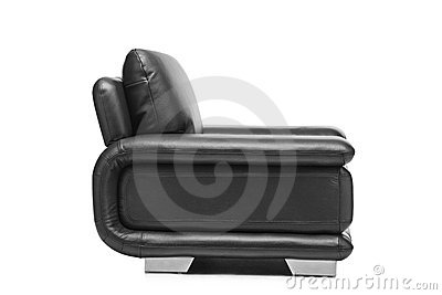 A studio shot of a leather black armchair