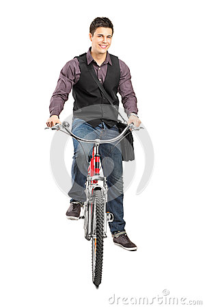 A studio shot of a man riding a bike