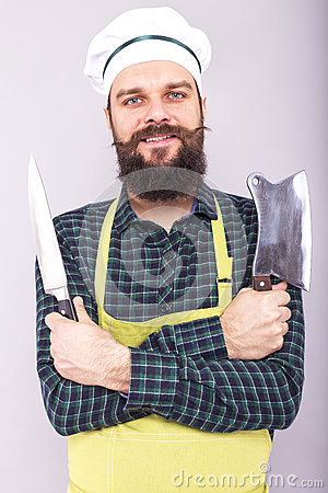Free Studio Shot Of A Happy Bearded Young Man Holding Sharp Knives Royalty Free Stock Photo - 68725365