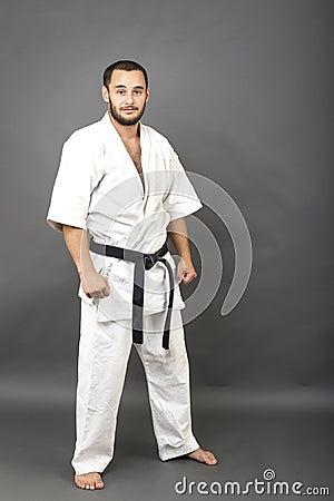 Free Studio Shot Of Young Man In White Kimono And Black Belt Stock Photo - 60101470