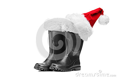 Studio shot of a pair of santa boots and santa hat