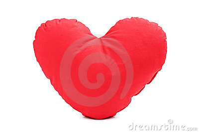 A studio shot of a red heart shaped pillow