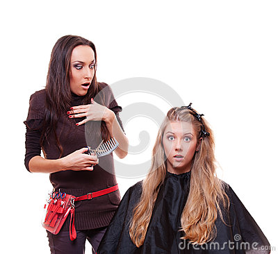 Studio shot of shocked hairdresser and client