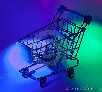 Studio shot of shopping cart in multicolor light