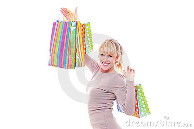 Studio shot of smiley woman after shopping