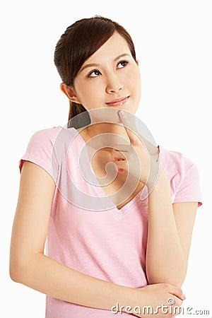 Studio Shot Of Thoughtful Chinese Woman