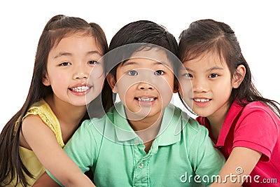 Studio Shot Of Three Chinese Children