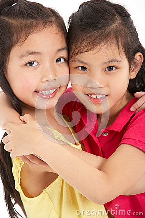 Studio Shot Of Two Chinese Girls