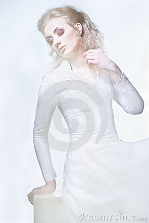 Studio shot of a young beauty wearing white dress