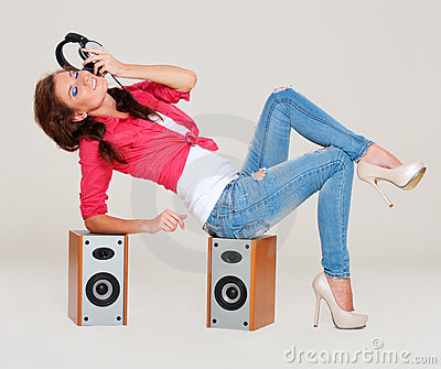 Studio shot of young woman listening the music