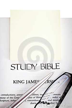 Study Bible with yellow notepad