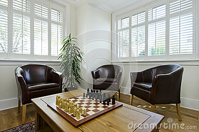 Study room with leather armchairs and chess board
