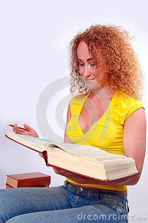 Studying happy young woman
