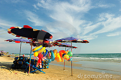 Stuff and umbrella against blue sea