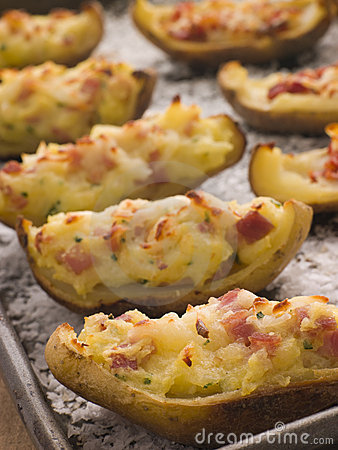 Free Stuffed Potato Skins A Tray With Sea Salt Stock Photos - 5575473