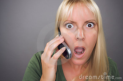 Stunned Blond Woman Using Cell Phone
