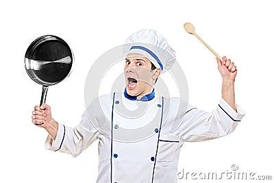 Stunned chef holding kitchen utensil