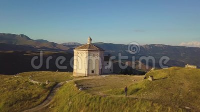 Stunning 4k fast aerial of countryside church in the Abruzzo valleys, Italy. Stunning 4k fast aerial drone footage of a countryside church at sunset in the stock video
