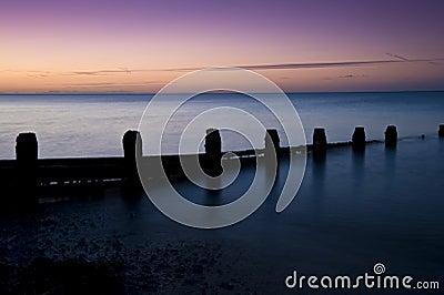 Stunning long exposure sunrise over calm sea