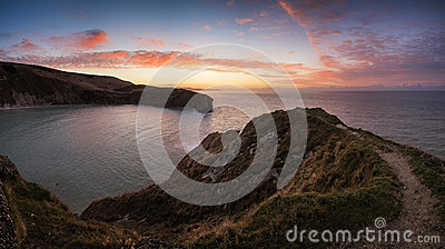 Stunning Summer sunrise over calm ocean landscape