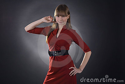 Stunning woman in red dress on black background