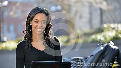 Stunning young African American female student on campus
