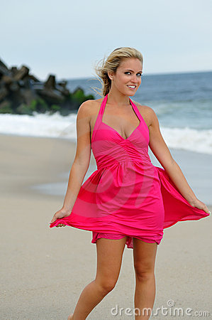 Free Stunning Young Blonde Woman Walking On The Beach Royalty Free Stock Photos - 20914158