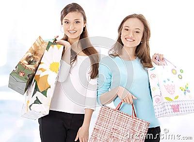 Stunning young women carrying shopping bags