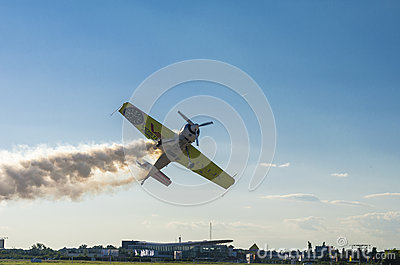 Stunt plane with smoke Editorial Photography