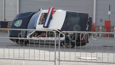 Stunt Show With Police Car. ROME, ITALY - OCTOBER 12, 2014: Stunt show with police car at the Rome Supercar Show