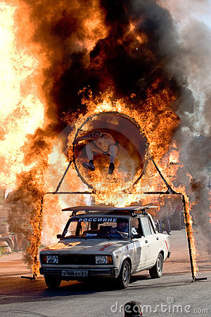 Stuntman Igor Zverev jumping through tube of fire Editorial Stock Photo