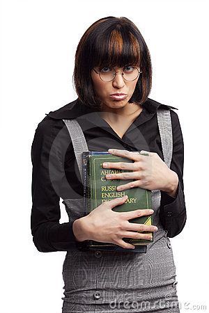 Stupid brunette schoolgirl hold books in the hands