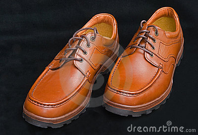 Sturdy brown laced walking shoes.