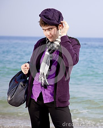 Style men in violet at the beach.