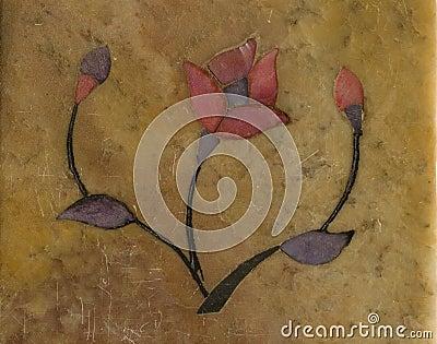 Stylised flower inlaid on stone